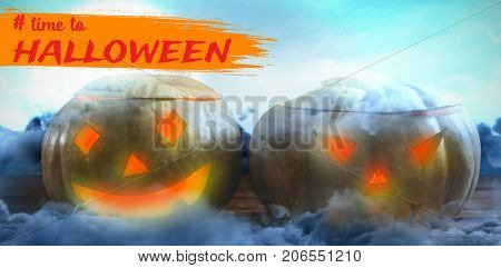 Graphic image of time to Halloween text against view of sea against sky