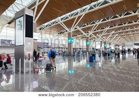 CALGARY CANADA - AUGUST 30 2017: Passengers at the international terminal of Calgary International Airport. Opened in 1938 the airport offers non-stop flights to major cities in North America Europe and East Asia.