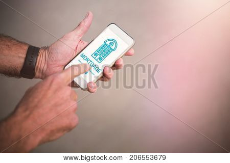 Graphic image of icon with mortgage text against cropped image of man using phone