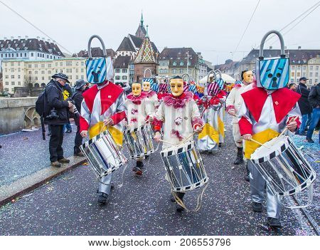 BASEL SWITZERLAND - MARCH 08 : Participants in the Basel Carnival in Basel Switzerland on March 08 2017. The Basel carnival has been listed as one of the top local festivities in Europe