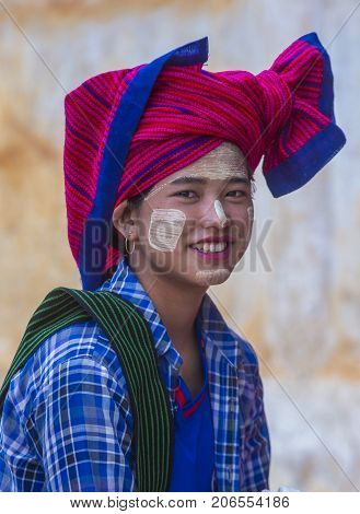 INLE LAKE MYANMAR - SEP 07 : Portrait of Intha tribe woman in Inle lake Myanmar on September 07 2017 The Intha people live along the Inle lake shores and on the lake itself