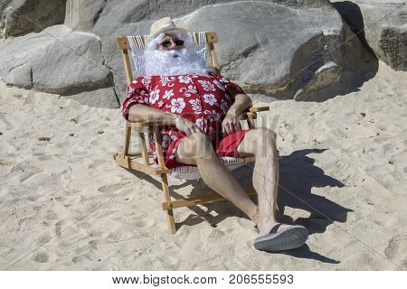 Santa Claus On Sunny Beach In Chair