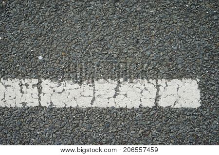 top view of white paint stripe on an asphalt road