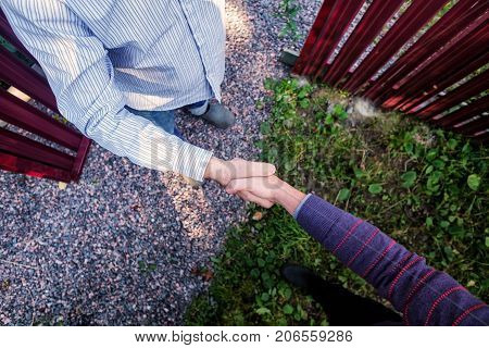 Men shaking hands. Top view of two men shaking hands while standing outdoor