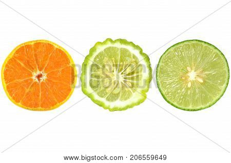 Halves of orange, kaffir lime and lime on white background