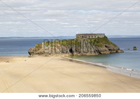 Tenby, UK: July 05, 2016: View of St Catherine's Island. St Catherine's Fort is a 19th century Palmerston Fort built as a defense during the Napoleonic war.