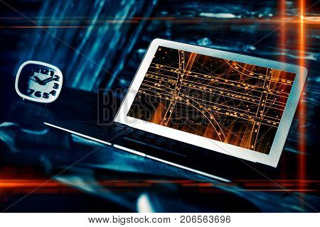 Side view of modern workplace with car network on laptop computer screen and clock. App concept. Double exposure