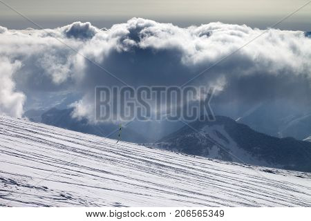 Ski Slope For Slalom And Sunlight Storm Clouds
