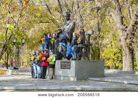Chernigov,Ukraine, October 19, 2011:Young people photographed near the unique monument to the Ukrainian poet Taras Shevchenko at the young age, Chernigov, Ukraine