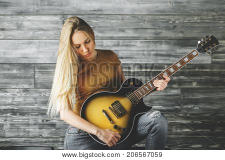 Attractive Woman Playing The Guitar