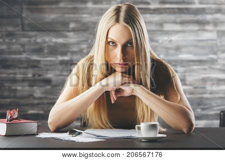 Pensive Woman Doing Paperwork