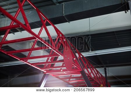 Closeup of pink steel, metal horizontal bars on a light silvery background, apparatus for sports events, competitions, exciting gymnastics events due to the power exhibited by gymnasts.