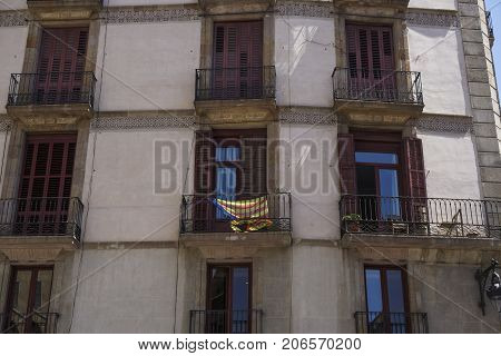 Catalan Flag Estelada Hanging From Balcony In Barcelona, Spain.