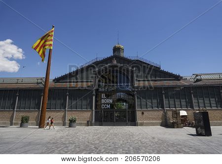 Barcelona, Spain - July 24 2017: El Born Center facade with Catalan flag. Cultural and Memorial Center facade housed in a former market, exhibits an archeological site of Barcelona from 1700s.
