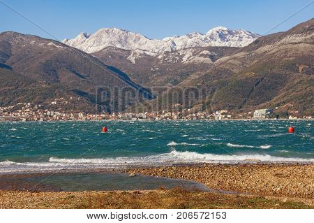 Bay of Kotor (Adriatic Sea) near Tivat town on a windy winter day. Montenegro