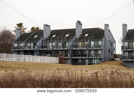 The Tannery Creek Condominiums stand beside the Little Traverse Wheelway, along the shore of Little Traverse Bay, near the Petoskey State Park, in Michigan.