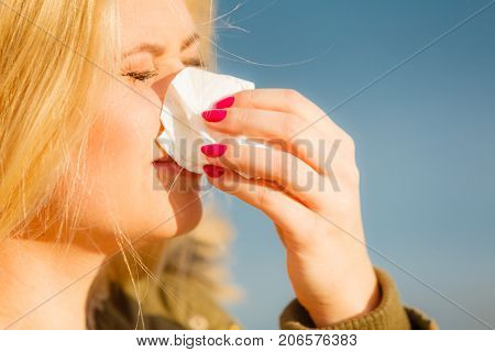Sneezing Woman Into Handkerchief, Outside Sunny Shot