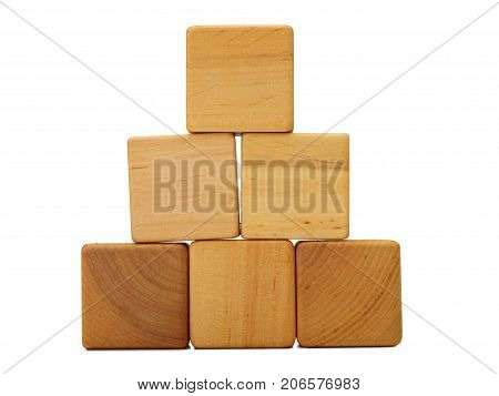 Several wooden cubes blocks with empty copy space for message word, isolated in white. Wooden cubes on white background with copy space. Still-life picture taken in studio with soft-box.