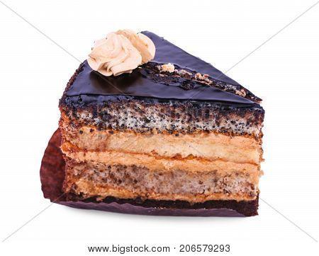 A close-up picture of a layered cake isolated over the white background. Sugar flavor. A piece of cake. Chocolate sweetmeats. Creamy dainty for tea-drinking. Copy space.
