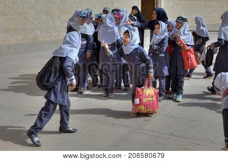 Fars Province Shiraz Iran - 19 april 2017: A group of girls in primary school during a hike on an excursion to the city.