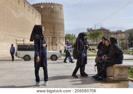 Fars Province Shiraz Iran - 19 april 2017: Iranian school girls are waiting for the beginning of the excursion to Karim Khan citadel.