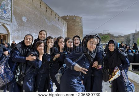 Fars Province Shiraz Iran - 19 april 2017: A group of Iranian schoolgirls having fun and posing looking into the camera lens.