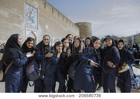 Fars Province Shiraz Iran - 19 april 2017: Iranian schoolgirls are having fun and posing at the sight of a tourist's camera.