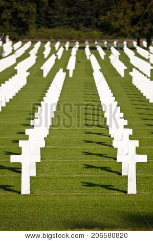 The American military cemetery Henri-Chapelle near Aubel in Belgium with white crosses in rows.