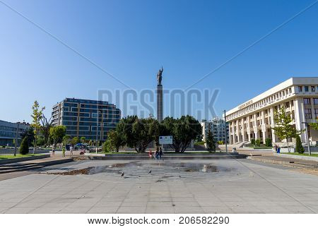 BURGAS BULGARIA - AUGUST 20 2017: Troikata Square a monument to the Soviet Soldier-Liberator - Alyosha (center) and the Court of Justice building (right).