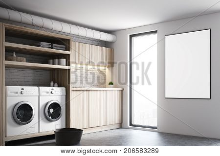 Modern laundry room interior with white and brick walls wooden consoles and shelves and two white washing machines. A poster on the wall. 3d rendering mock up