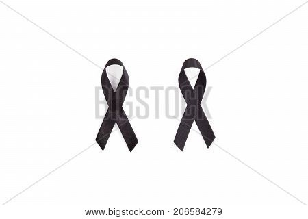 Texture of the knot front and back. Black awareness ribbon. Melanoma and skin cancer prevention. Health and RIP concept
