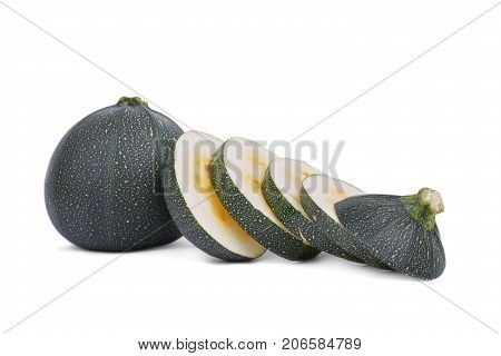 Close-up of perfect round slices of juicy, natural dark green zucchini, isolated on a white background. A whole organic vegetable near the slices of zucchini with seeds. Summer ingredients.