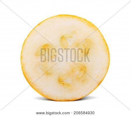Close-up of a single slice of organic, raw and fresh zucchini, isolated on a white background. A perfect round slice of a yellow zucchini with bright seeds. Healthful, ripe summer ingredients.