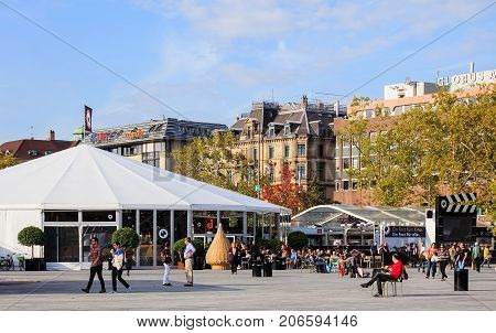Zurich, Switzerland - 29 September, 2017: people and the venue of Zurich Film Festival on Sechselautenplatz square. Zurich Film Festival takes place annually at the end of September since 2005, in 2017 it lasts from 28 September till 8 October.