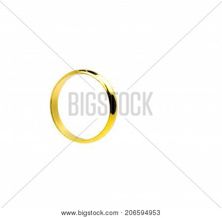 One gold ring isolated on white background with copy space just add your own text