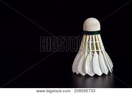 Badminton ball or shuttle on the black background with copy space for advertising Sport concept Fitness concept