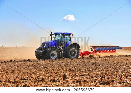 Combine Harvester, Working On The Harvest Of A Ripe Sunflower. Agriculture. Cultivated Area.