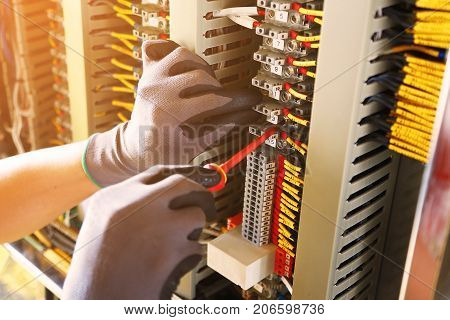 Electrical terminal in junction box and service by technician. Electrical device install in control panel for support program and control function by PLC. routine visit check equipment by technician.