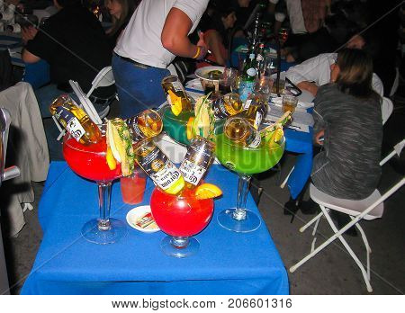 Miami, USA - January 01, 2014: The people drinking colourful drinks or coctails at Miami Beach, USA on January 01, 2014