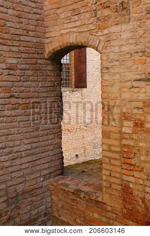 Archway in ancient fortress in Vignola Italy