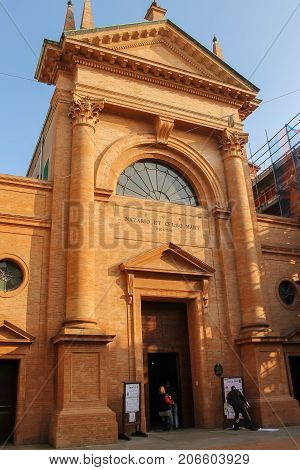 Vignola Italy - October 30 2016: People near old church of the Saints Nazarius and Celsus. Emilia Romagna Modena