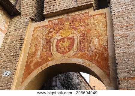 Vignola Italy - October 30 2016: Antique painting on old arch in Vignola castle. Emilia-Romagna Modena