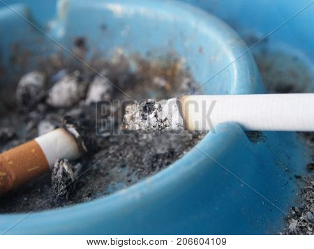 Ashtray And Cigarette. A Smoking Place With A Wooden Table