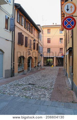 Vignola Italy - October 30 2016: Tourists in narrow streets of old city. Emilia-Romagna Modena