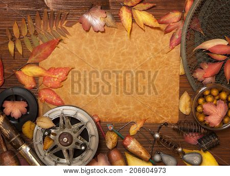 Fishing tackle on vintage wooden background