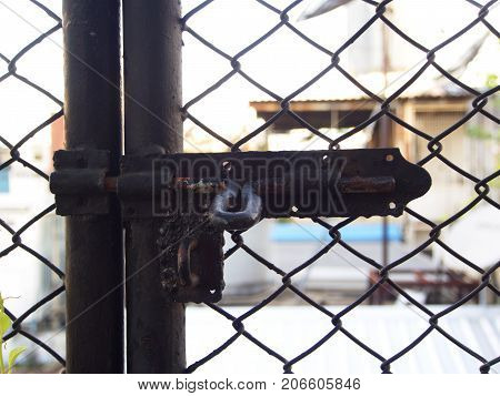 an Old and Retro Black Latch at the gate of the cage house.