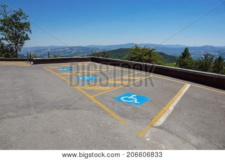 Parking spaces reserved for the disabled in outdoor lot for the public .