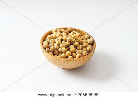 Closed Up Isolate Heap Of Yellow Soy Beans In Mini Wooden Bowl. The Best Protein From Natural And Me