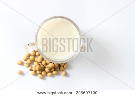 Isolate Soy Milk And Beans On White Background.