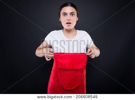 Amazed Female Employee Wearing Red Apron